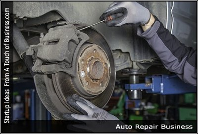 Image of mechanic working on brakes