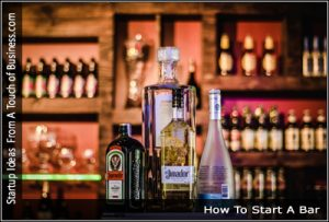 Open bottles of alcohol on a bar