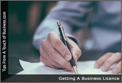 Image of a man signing a document