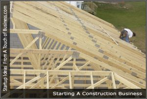 A man working on a truss on a roof