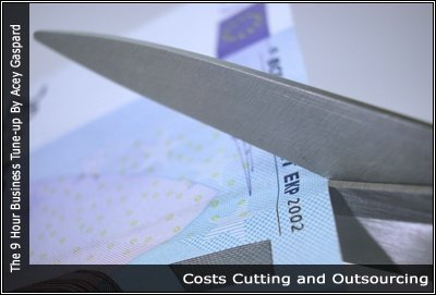 Image of scissors using currency