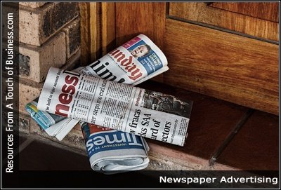 Image of newspapers on a doorstep
