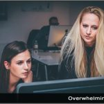 Image of two women working in front of a computer
