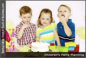 Three kids standing in front of a birthday cake