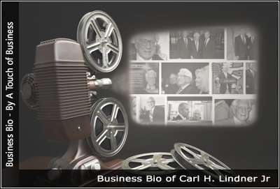 Image of a projector displaying images related to Carl H. Lindner Jr