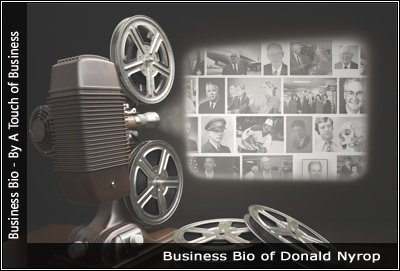Image of a projector displaying images related to Donald Nyrop