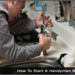 Image of a man fixing a kitchen sink