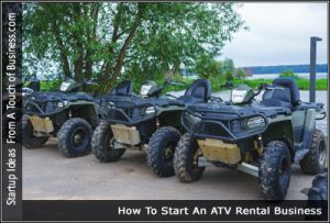 Four green ATV's parked in a row