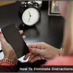 image of women using a cell phone at a desk