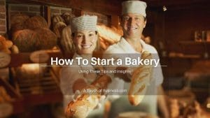 A man and woman standing in a bakery holding bread