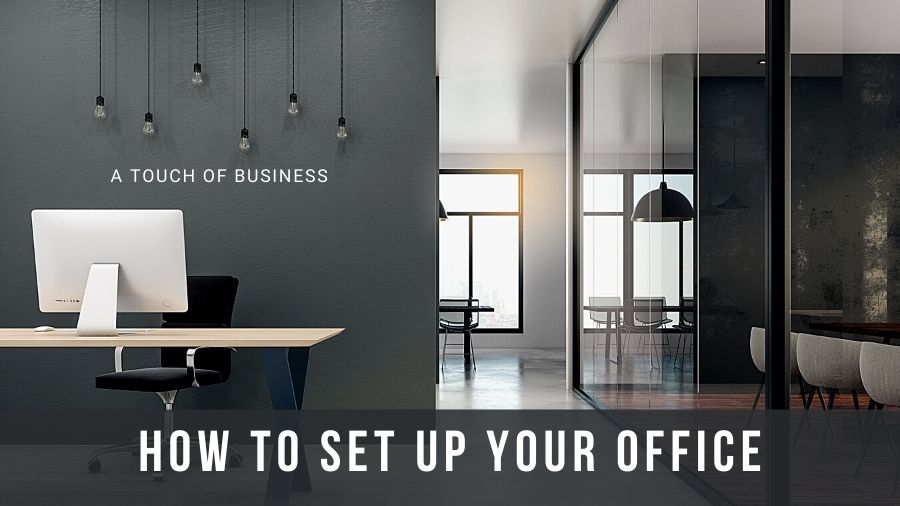 modern office using open concept, glass, and hanging lights