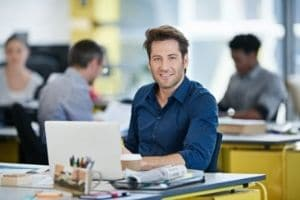 A man smiling in a office