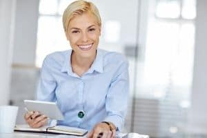 A smiling woman working at a desk