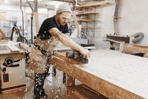 a man working in a woodworking shop